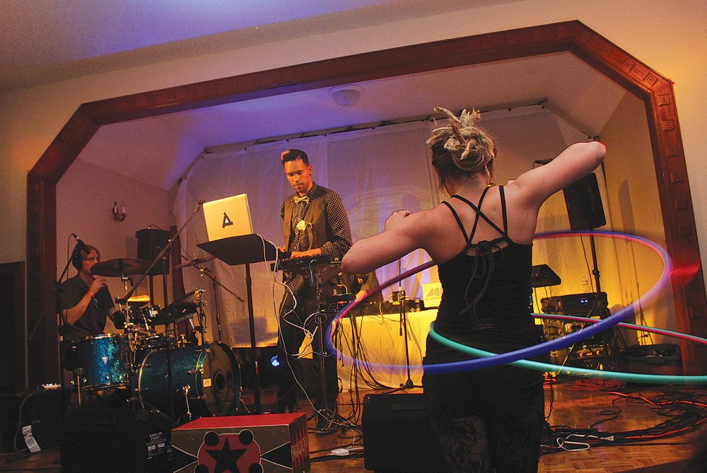 Haley Jodances with a hoop asLafa Taylor and his group mix hip hop and bass music, taking KMUD's circus party into the wee, wee hours of Sunday, April 6at Arcata'sPortuguese Hall. - PHOTOS BY BOB DORAN