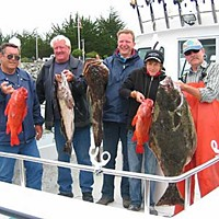 Two If By Sea Happy clients aboard Tim Klassen's charter boat with their pretty catch of rockfish. Photo by Sherry Klassen