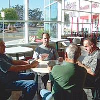 Mall Town Harold (left, in the blue-checked shirt), Darrell, Rod and Arnie have been playing cards in the Bayshore Mall's food court for seven years. They get there at 6:30 a.m. or 7 and walk first. Photo by Heidi Walters