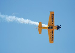"Herman Bouler's ""Knife Edge"" at Silver Linings captures Matt Chapman piloting an Eagle-580 at the Tucson Air Show."