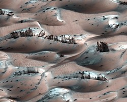 NASA PHOTO - HiRISE 2009 image taken near the Martian North Pole. The dark streaks are landslides of basalt sand overlying dunes covered with white frozen carbon dioxide (dry ice).