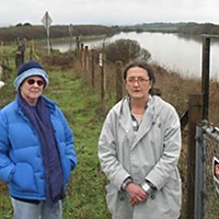 Water, Dirt and Time Homes on the brink: Karen Earls (right) and her Verwer Court neighbor, Beryl Feldman, on the Mad River bluffs. Photo by Bob Doran.