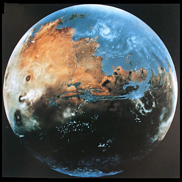 How Mars might have looked four billion years ago, with oceans and active volcanoes. (From Barry Evans' book The One-Way Comet, painting by Michael Carroll.