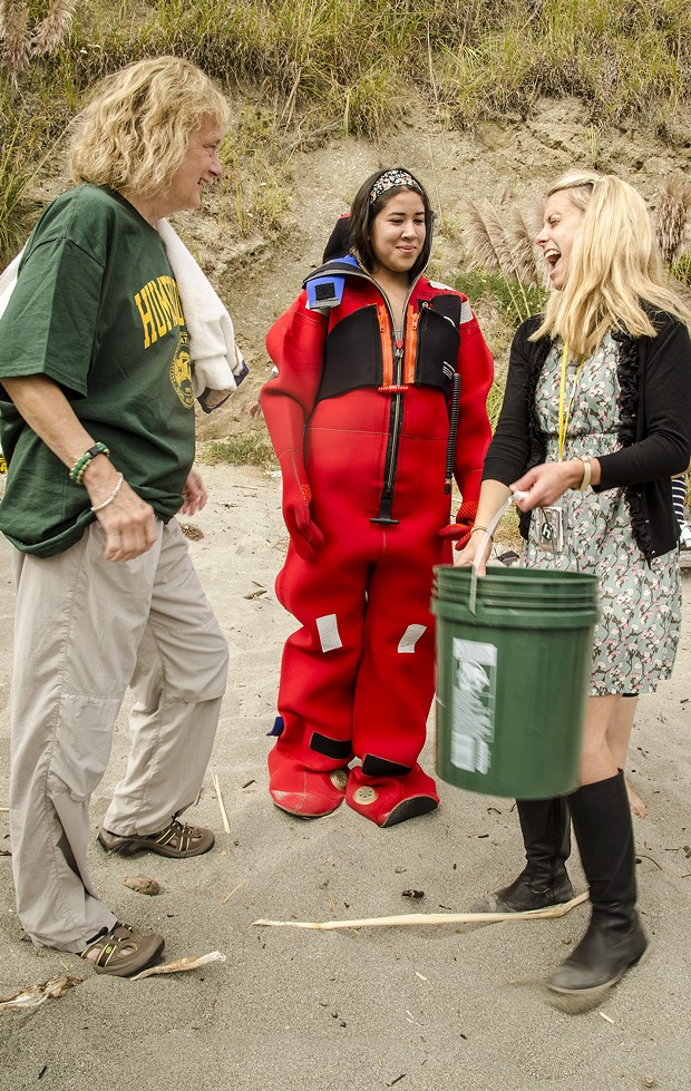 "HSU President Lisa Rossbacher, freshman Veronica Rivera (in a dry suit) and campus staffer Courtney Haroldson discuss preparations for the ""sustainable"" Ice-Bucket Challenge. - MARK LARSON PHOTOGRAPHY"