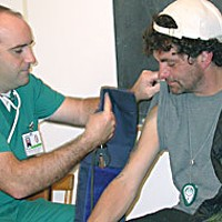 Everyone Is Connected HSU student nurse Todd Dixon gets ready to check J.D.'s blood pressure, which might have risen a tad after his fright with the flu shot. Photo by Heidi Walters