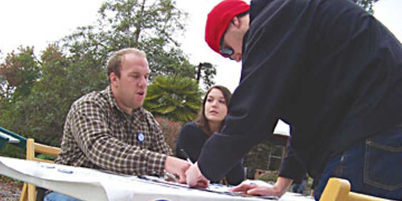Campus In Crisis HSU Students Tony Snow, left, and Angela Pine gather signatures protesting proposed CSU budget cuts on the HSU quad last week.