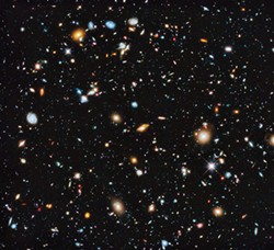 Hubble telescope composite photograph of 800 exposures of a tiny patch of sky (equivalent to looking through an 8-foot-long soda straw) showing 10,000 galaxies. PHOTO COURTESY OF NASA