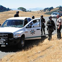 Conflicting Reports Humboldt County Sheriff Mike Downey talks with members of the SWAT team near the scene of a fatal 2011 shooting at a marijuana growing operation in Kneeland. Photo by Thadeus Greenson