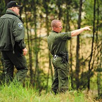 Conflicting Reports Humboldt County Sheriff's deputies search for a suspect after a robbery in 2010. Photo by Thadeus Greenson