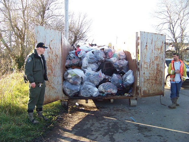 Humboldt County Sheriff's Senior Correctional Officer Trent Hauger and his inmate crew loaded up two of these 40-yard dumpsters last Friday with junk from one man's camp. - PHOTO BY HEIDI WALTERS