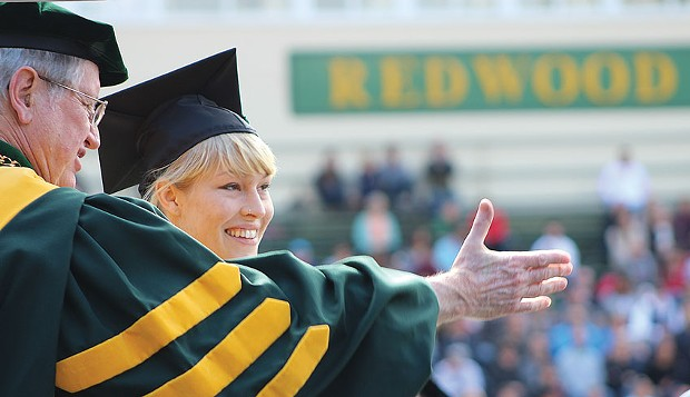 Humboldt State University President Rollin Richmond awards Bryn Robertson her graduate degree at the college's centennial Commencement on Saturday, May 17. - PHOTOS BY BOB DORAN