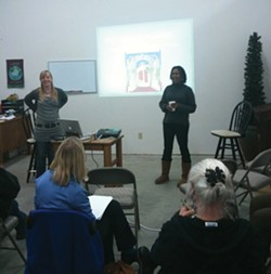 PHOTO BY JACOB SHAFER - Instructors Alexis Wilson Briggs (left) and Kyndra Miller lead a class about feminism and cannabis.