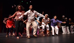 PHOTO COURTESY OF HOWIE KAUFMAN - Instructors Susana Arenas and Silfredo La O dancing the conga in the finale of last year's faculty performance.