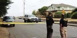 PHOTO BY THADEUS GREENSON - Investigators survey the scene on Allard Avenue.