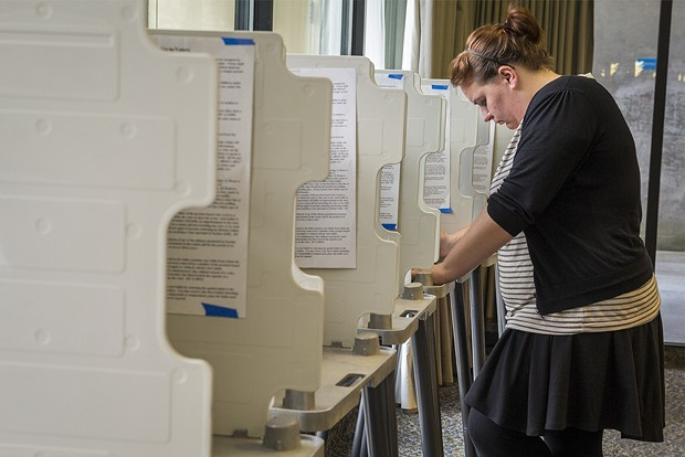 Samantha Boyd studies the voting catalog before casting her ballot at HSU. - MANUEL J. ORBEGOZO