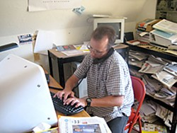 Jack Durham working on his computer at 'The McKinleyville Press.' Photo by Meghannraye Sutton.