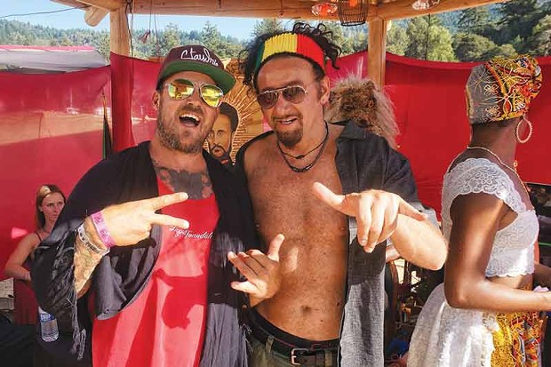 Jamin Hazelaar, lead singer of rock/reggae band Thicker Than Thieves, and dub/electronica artist Gaudi hang loose at Reggae all weekend after playing sets opening Friday and closing Thursday respectively. - PHOTO BY BOB DORAN
