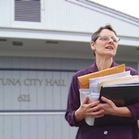 Taking on City Hall Janelle Egger and an armload of documents in front of Fortuna city hall. Photo by Heidi Walters