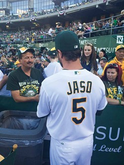 PHOTO COURTESY OF THE OAKLAND ATHLETICS - Jaso signs autographs in Oakland on July 5.