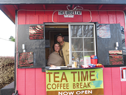 PHOTO BY AMY BARNES - Jennifer Thompson with fiancée Brendon Askay in The Loose Leaf Mobile Tea Cart.