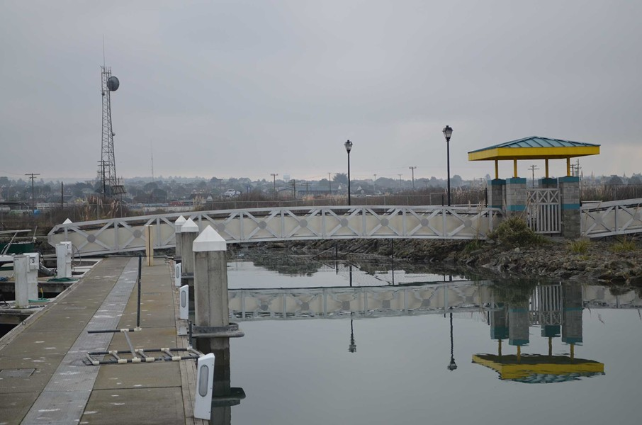Ramps to the Wharfinger dock were nearly level as the tide receded. - GRANT SCOTT-GOFORTH