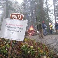 Klamath: Direct Action! Klamath Justice Coalition activists block a log road in December 2009 to protect spiritual trails. Photo by Craig Tucker.