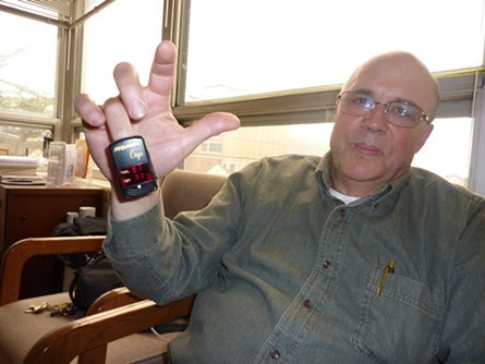 Lance Madsen in 2011, showing reporter the oximeter that measures his pulse and blood oxygen. - PHOTO BY RYAN BURNS