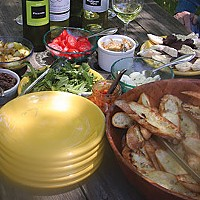 Left: A recent picnic prepared from our new cookbook, Bruschetta, Crostini and other Italian Snacks, by Maxine Clark: Char-grilled bruschetta topped with: olive tapenade, soft eggs, white bean spread, fresh arugula in olive oil, tomatoes, anchovies, red p