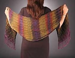 Linda Hartshorn wearing one of her creations, a woven shibori shawl. Photo by Robin Robin.