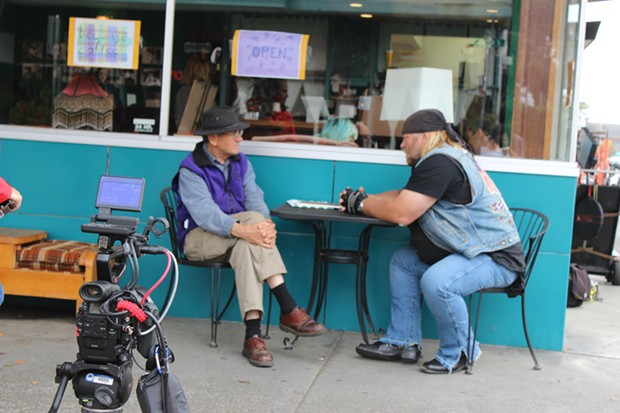 Local historian Ray Hillman (left) speaks with Stan Ellsworth for an upcoming episode of American Ride as a film crew looks on in Old Town Eureka. - THADEUS GREENSON