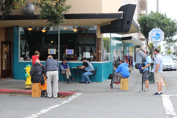 A film crew huddles at the corner of F and Third streets in Eureka on Monday. - THADEUS GREENSON