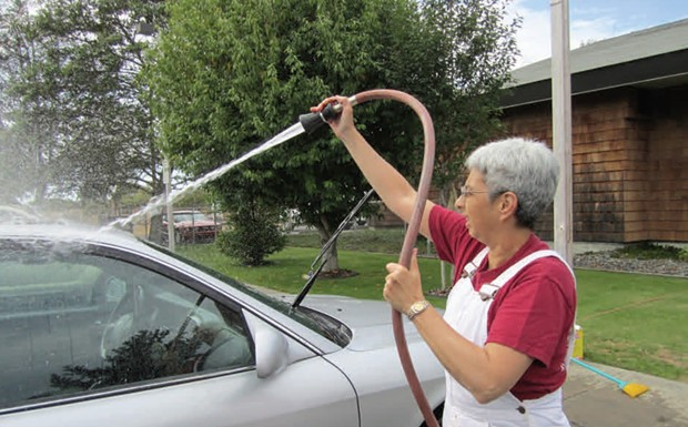 Nancy Dean, meteorologist in charge of the Weather Forecast Office in Eureka, washing cars as part of a fundraiser in 2011. - PHOTO COURTESY OF THE NATIONAL WEATHER SERVICE