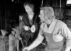 COURTESY OF ADVENTURE CLUB - Lynette Mullen learning blacksmithing at Blue Ox with Eric Hollenbeck.