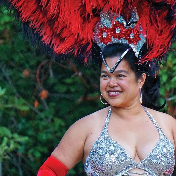 Maria Vanderhorst of Samba na Chuva dances at a wild party in Maple Creek Saturday night, Aug. 16. - PHOTO BY BOB DORAN