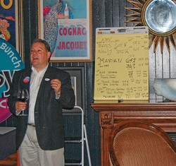 PHOTO BY ANDREW GOFF - Matthew Owen, husband of Virginia Bass, rallies supporters at Avalon.