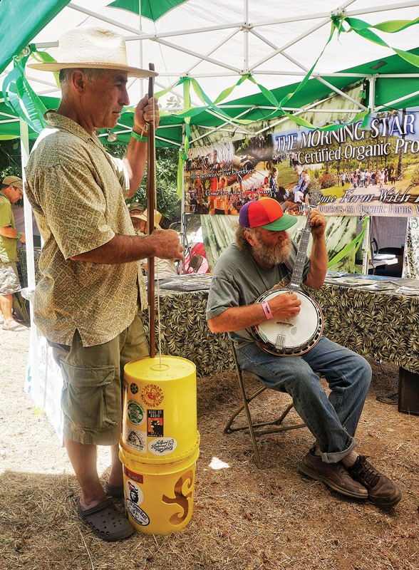 McKinleyville's Raul Lozano plays his homemade gutbucket bass in a jam session at the Kate Wolf Music Festival on Saturday, June 28, at Black Oak Ranch in Laytonville. - PHOTO BY BOB DORAN