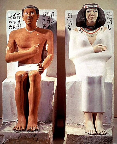 Melanin production is contrasted in these 4500-year-old statues from Meidan, Egypt, of Prince Rahotep and his consort Nofret. (Unknown photographer.)