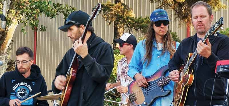 "Members of Motherlode play some funk for the crowd at the Humboldt County Fair Saturday, Aug. 23. despite being misidentified in the program as a ""country"" band called ""Mother Lode."" - PHOTO BY BOB DORAN"