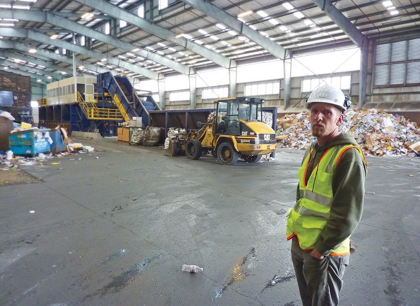 Mike Seeber, Arcata Community Recycling Center's operations director, surveys the insides of the agency's state-of-the-art Samoa processing facility. - PHOTO BY RYAN BURNS