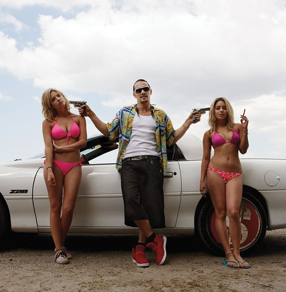 Misogynistic male fantasy or biting social critique? Whatevs, pass the Cuervo.  Ashley Benson, James Franco and Vanessa Hudgens in Spring Breakers.