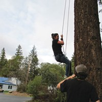 Klamath: Direct Action! Molli White dangles from a line as she learns the art of tree-climbing, Earth First!-style. Photo by Malcolm Terence.