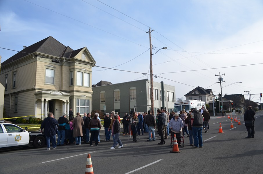 Mourners gather on in front of St. Bernard's church on H and Sixth streets in Eureka. - GRANT SCOTT-GOFORTH