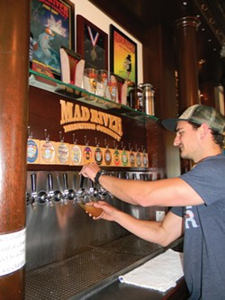 PHOTO BY CARRIE PEYTON DAHLBERG - Nathan Sailor, lead bartender at Mad River Brewery, poured plenty of pints of River Day Session IPA on April 29, the first day of its release.