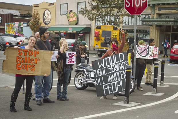 Protesters wave signs at the intersection of Ninth and G streets in Arcata on Oct. 18. - PATRICK EVANS