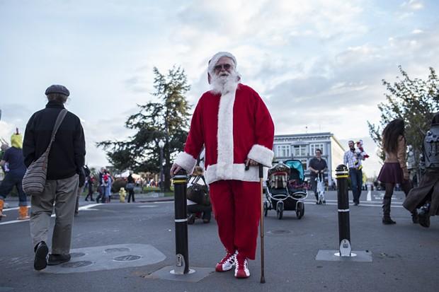 Santa Clause makes a rare pre-season appearance on the Plaza Friday evening. - ALEXANDER WOODARD