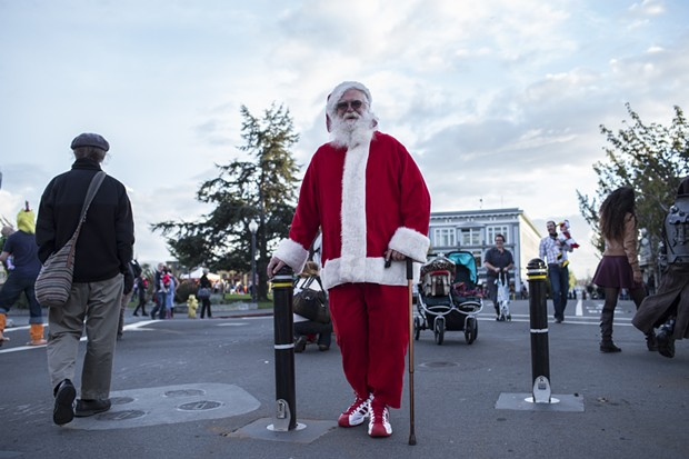 Santa Clause makes a rare pre-season appearance on the Plaza Friday evening. - ALEXANDER WOODARD