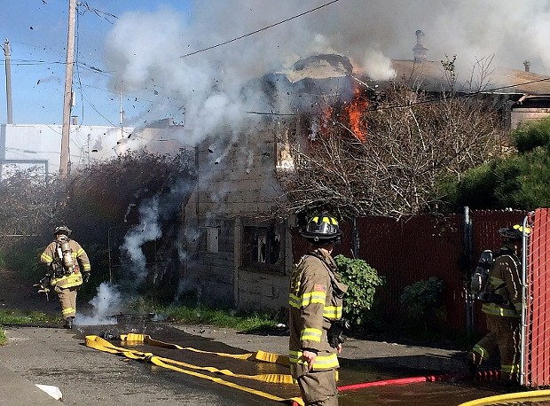 Debris is blown from the structure as crews from Humboldt Bay Fire work to contain the blaze. - MARK MCKENNA