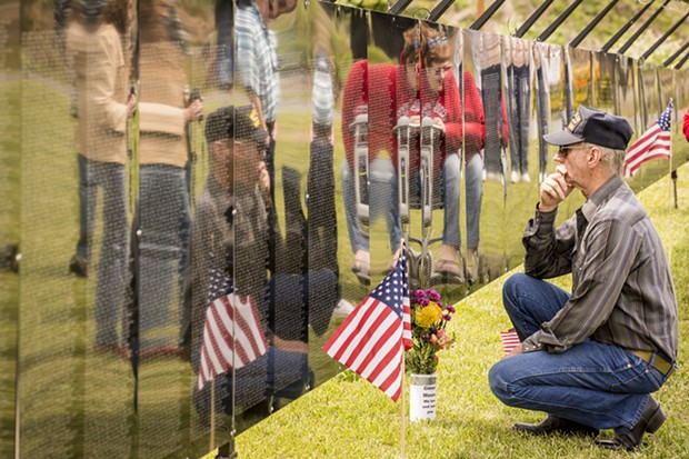 "Vietnam veteran Darryl Whiteaker, of Willow Creek, paused to find names of comrades on the replica Wall on Friday.  ""I experienced two Tet offenses,"" he said. ""One was enough."" He served there in 1967 and 1968. - MARK LARSON"