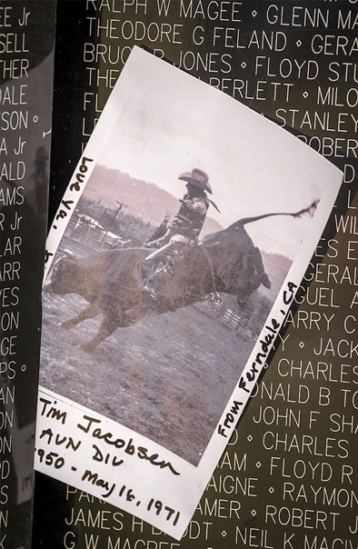 This photo of Tim Jacobsen, of Ferndale, who was killed in Vietnam at age 21, was placed on the replica memorial Wall. - MARK LARSON
