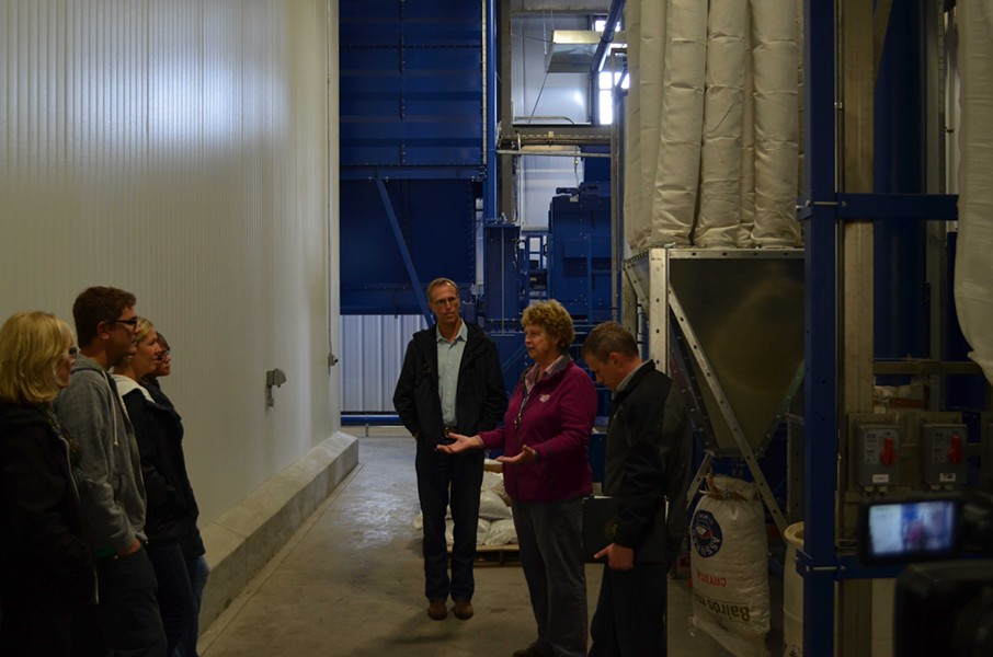 Congressman Jarad Huffman and brewery owner Barbara Groom talk in the sweet and earthy smelling grain room. - GRANT SCOTT-GOFORTH
